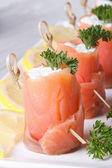 Delicious rolls with salmon and cream cheese vertical — Stock Photo