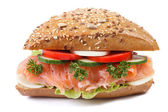 Sandwich with salmon and vegetables closeup isolated front — Stock Photo