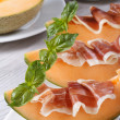 Italian appetizer: melon with ham vertical close up — Stock Photo #52110803