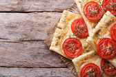 Puff pastry pies stuffed with cheese and tomato top view — Stock Photo