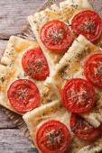 Puff pastry with tomato and cheese vertical. top view — Stock Photo