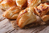 Pies of puff pastry close up horizontal — Stock Photo
