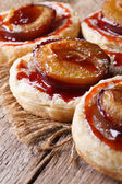 Cakes of puff pastry with plums macro vertical  — Stock Photo