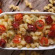Pasta baked with cherry tomatoes and sausages top view — Stock Photo #52649987