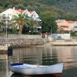White fishing boat near the village Stoliv in Montenegro. — Stock Photo #54961741