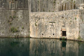 Walls of the medieval fortress surrounded by a moat in Kotor — Stock Photo