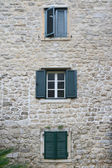 Windows with shutters in the three storey building — Stock Photo