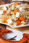 Fusilli pasta with feta and baked pumpkin close-up — Stock Photo