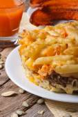 Pasta baked with meat, cheese and pumpkin and juice. vertical — Stock Photo