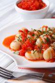 Potato gnocchi in tomato sauce, closeup. vertical  — Stock Photo