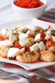 Potato gnocchi with mozzarella in tomato sauce, vertical  — Stock Photo