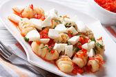 Gnocchi with mozzarella and tomato macro. Horizontal — Stock Photo
