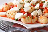 Delicious potato gnocchi with mozzarella and tomato sauce, macro — Stock Photo