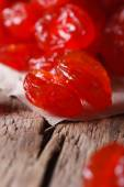 Dried red cherries macro on a wooden, Vertical — Stock Photo