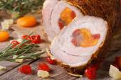 Meat pork roll with apricot, cherry and pineapple horizontal — Stock Photo