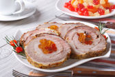 Pork roll with apricot and cherry closeup on a plate. — Stockfoto
