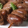 Grilled chicken hearts on skewers on a white plate close-up — Stock Photo #57749273