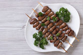 Chicken hearts grilled on skewers. top view — Stock Photo