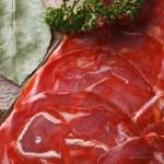 Chorizo sausage on the table macro. horizontal top view — Stock Photo #57901569