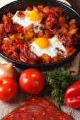 Fried eggs with chorizo  and the ingredients on the table. — Stock Photo