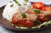 Meatloaf with rice and tomatoes on a plate close-up — Stock Photo