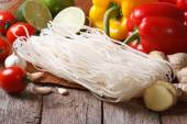 Dry rice noodles with fresh vegetables on a table close-up — Stock Photo