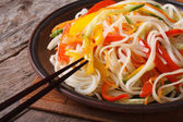 Rice noodles with peppers, carrots and zucchini closeup — Stock Photo