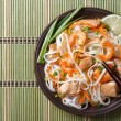 Asian food: rice noodles with chicken, shrimp and vegetables — Stock Photo #59306095