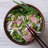 Soup pho bo with beef, rice noodles and vegetables top view — Stock Photo