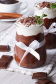 Chocolate mousse with whipped cream close-up. Vertical — Stockfoto
