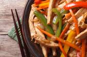Chicken with vegetables macro and chopsticks top view — Stock Photo