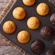 Chocolate and vanilla muffins in baking dish top view — Stock Photo #60603071