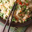 Fried rice with egg, peas, carrots close-up vertical top view — Stock Photo #60605535