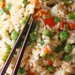Fried rice with egg, peas, carrots macro vertical top view — Stock Photo #60605857
