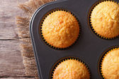 Golden delicious muffins in baking dish macro horizontal top vie — Stock Photo