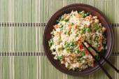 Japanese fried rice with egg and peas top view horizontal — Stock Photo
