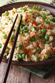 Asian fried rice with egg and vegetables close-up, vertical — Stock Photo
