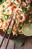 Fried rice with shrimp and vegetables and chopsticks. Vertical — Stock Photo