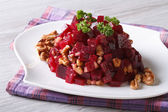 Beetroot salad with walnuts close-up horizontal — Stock Photo