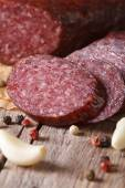 Sliced smoked sausage with spices vertical macro — Stock Photo