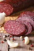 Sliced salami in a rustic style. vertical macro — Stock Photo