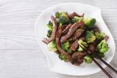 Asian beef with broccoli and chopsticks. horizontal top view — Stock Photo