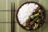 Beef with broccoli and rice close-up. horizontal top view — Stock Photo