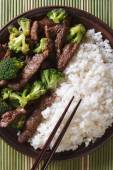 Beef with broccoli and rice macro. vertical top view — Stock Photo