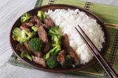 Asian beef with broccoli and rice close-up. Horizontal — Stock Photo