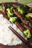 Beef with broccoli and rice macro, chopsticks. vertical top view — Stock Photo