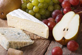 Cheese with grapes and pears close-up horizontal — Stock Photo
