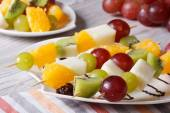 Fresh fruit on skewers close-up. Horizontal — Stock Photo