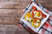 Fried eggs in peppers on a plate. horizontal top view — Stock Photo