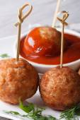 Grilled meatballs nd tomato sauce on a plate vertical macro — Stock Photo